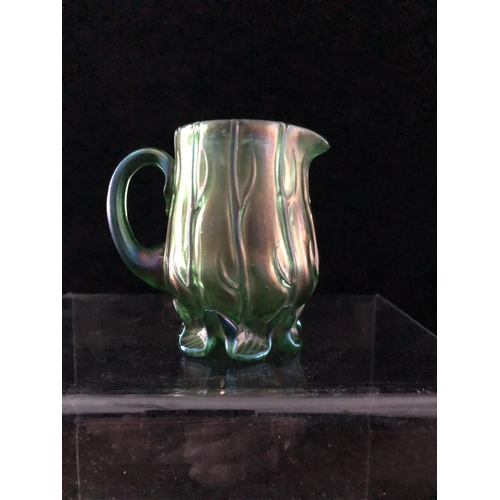 48 - A Loetz Neptun iridescent blue green glass cream jug, the body moulded with strands of seaweed over ...