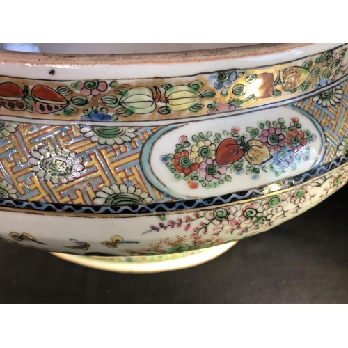 5 - A Chinese porcelain tureen, decorated in famille rose colour with Cockrells within a fenced enclosur...