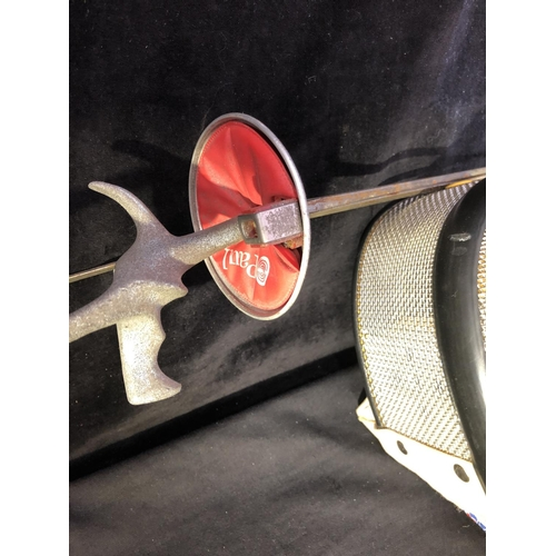 53 - A Leon Paul Fencing mask; and two epee (3)...