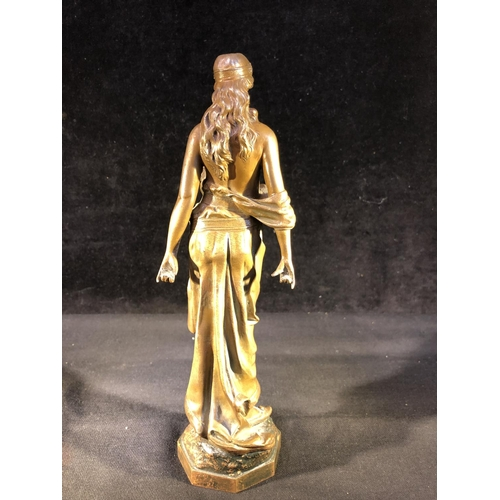 7 - E Telb? - A gilded bronze figure of a semi clad Arabian girl, standing with arms held backward, rock...
