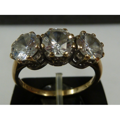 43 - Four rings - comprising a solitaire diamond ring, the 0.20ct stone set in white metal butterfly shou...