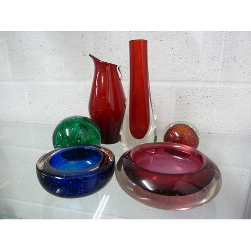 35 - Whitefriars - a 9571 glass vase in cased ruby; a beak jug in ruby; a green controlled bubble paperwe...