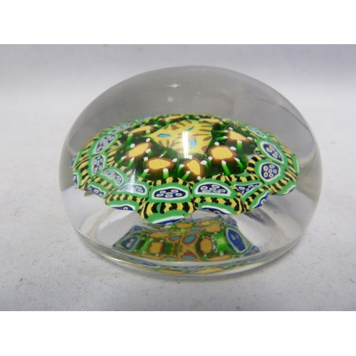43 - Strathern - a glass paperweight, predominantly of brightly coloured concentric canes in yellow and g...