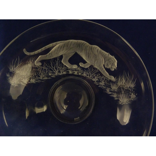 42 - Michael Fairbairn - Tiger, a colourless glass low pedestal bowl, engraved with the big cat in a gras...