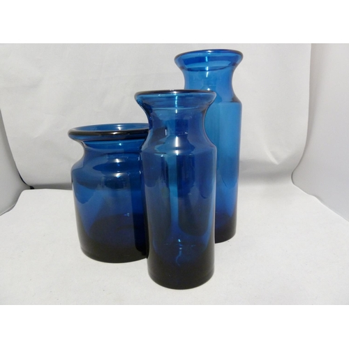 53 - Hovmantorp - three  cobalt blue glass vases, of cylindrical form with inverted rims, unmarked, one w...