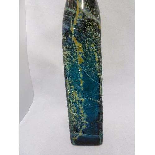 22 - Mdina glass - a large attenuated bottle with random strapping, of amethyst, blue and sand colouratio...