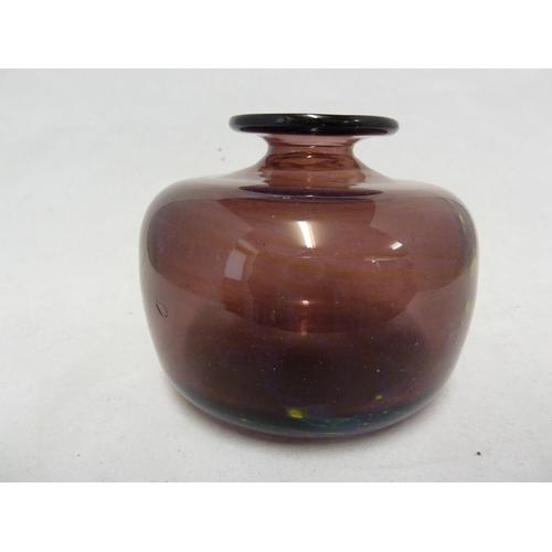 25 - Mdina glass - a mauve squat globular vase with chloride streaking, polished pontil, 9cm high x 10.5c...