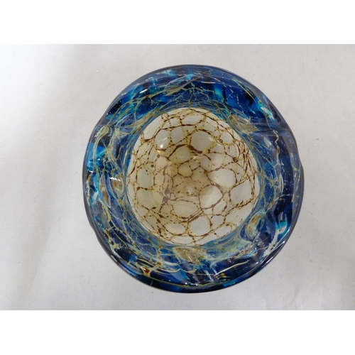 26 - Mdina glass - a bowl with everted rim, the textured blue glass rim folded over a sand and rust strea...