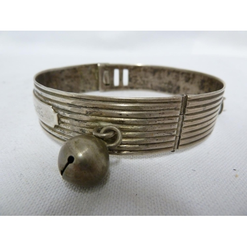 10 - A white metal dog collar, the whole reeded and with reserve inscribed Contessa Orsetti and with bell...