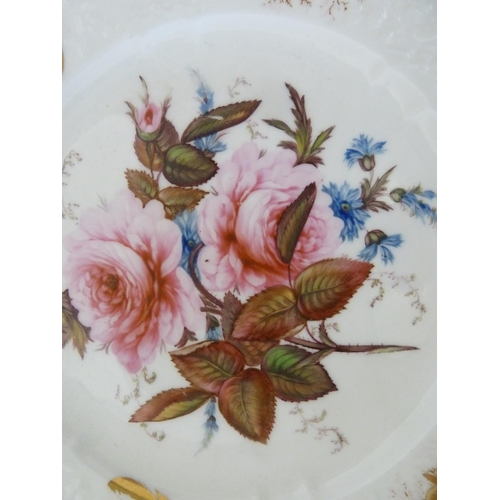 60 - A Coalport porcelain plate, possibly decorated by John Rose, the well finely painted with roses, cor...