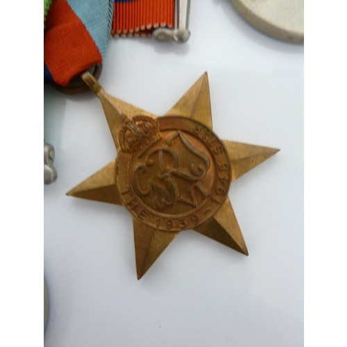 116 - Medals and decorations - World War II, a Medal Office card board box, addressed to Dr N.D.Smith, Lon...