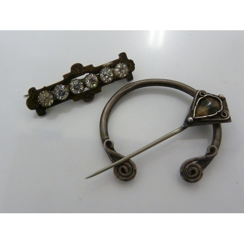 42 - A Celtic style cloak pin set with a moss agate stone, stamped SILVER; and a bar brooch set  with six...