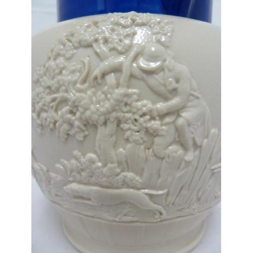 53 - An English smear glazed hunting scene pottery jug, probably Davenport, a bright blue glaze to neck, ...