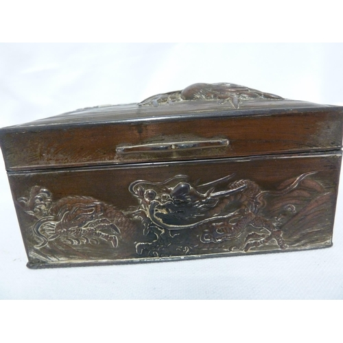 130 - A Japanese lacquer box of rectangular section and bombe outline, decorated with birds and chrysanthe...