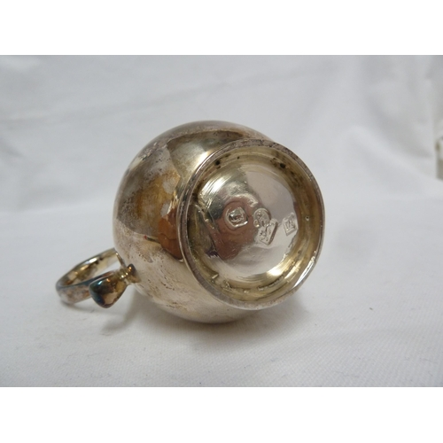 14 - A very fine George II silver sparrow beak cream jug, of plain baluster form on a reeded foot with sc...