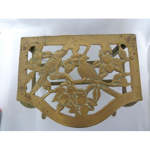 93 - A brass trivet, the top pierced and cast with birds and fruit, 14.5cm high