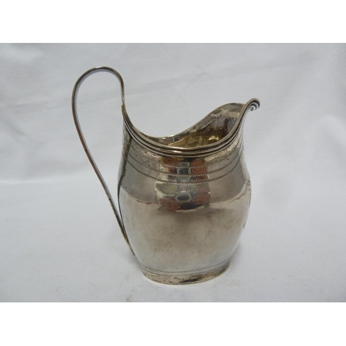 23 - A George III silver cream jug, of small size, the bellied body bright cut with a shield reserve and ...