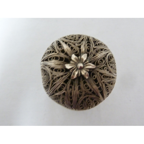 24 - A silver filigree pomander, perhaps Maltese, of cylindrical form with domed pull off cover surmounte...