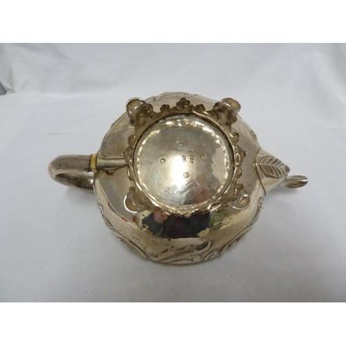 26 - An early Victorian silver batchelors teapot, of squat circular form with scroll and foliate decorati...