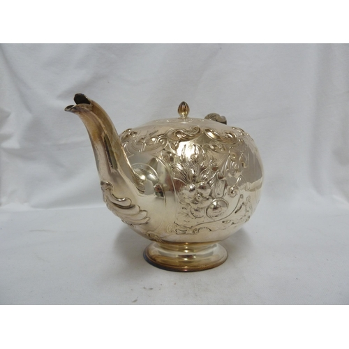 27 - Scottish Interest - A silver bullet shaped tea set, embossed with flowers and scrolls about vacant c...
