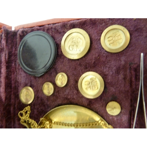 28 - A set of brass gold scales, with weights in grammes, in fitted case.
