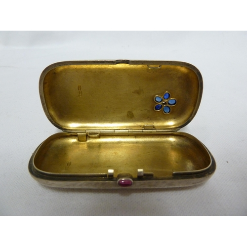 29 - A gem set Russian silver box, of rounded rectangular shape the plannished surface set with oval sapp...
