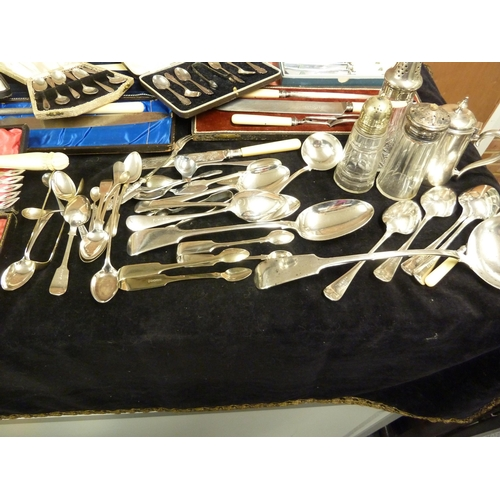 38 - A quantity of silver plated wares, including a pair of fish eaters of an unusual design of a fish ca...