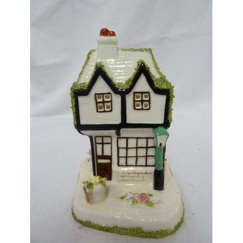 49 - Coalport - The Old Curiosity Shop; and the Gate House, two pastille burners, 13cm max; and a German ...