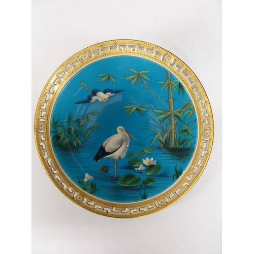 52 - A Minton cabinet plate with pierced gilded and jewelled fretwork rim about a design of storks, bambo...