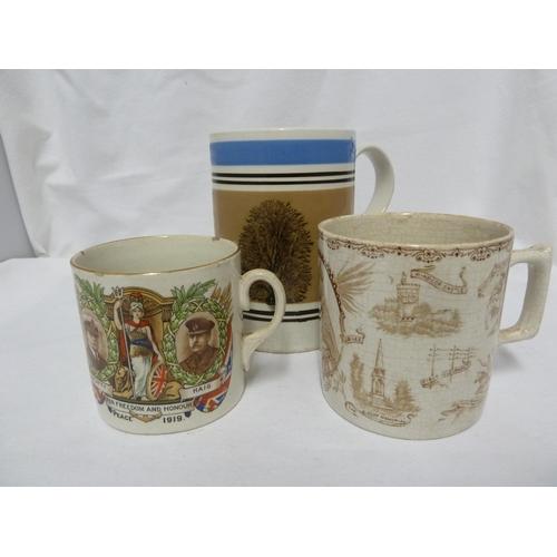 59 - A Mocha Ware tankard, banded in blue, black and ochre, 12.7cm high; an 1897 Jubilee mug, printed in ...