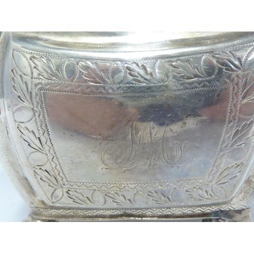 9 - A silver cream jug , of rectangular section with shaped upper rim, the sides with repousse reserves ...