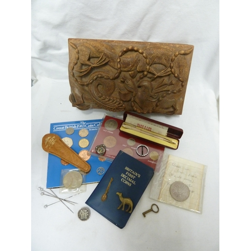 90 - A Vietnamese carved wooden jewel box, with key; a white metal brooch with Chinese character; a micro...