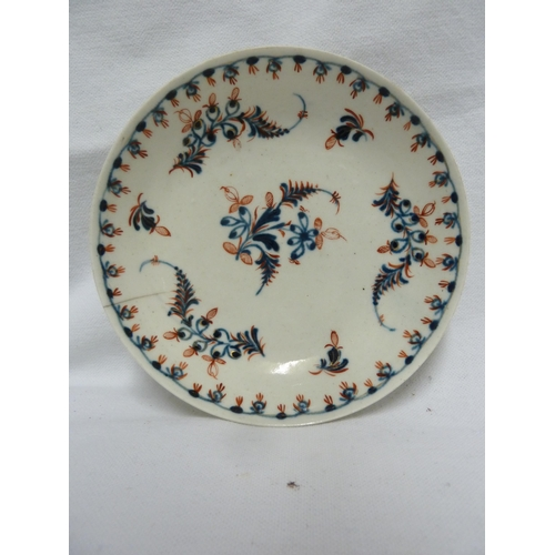 46 - A Liverpool porcelain tea bowl and saucer, probably John Pennington, painted in blue with Mares Tail...