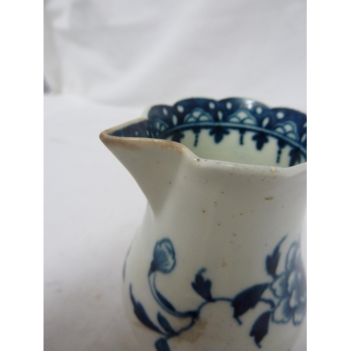 51 - A Worcester porcelain sparrow beak cream jug, painted with the Scalloped Peony pattern, of baluster ...