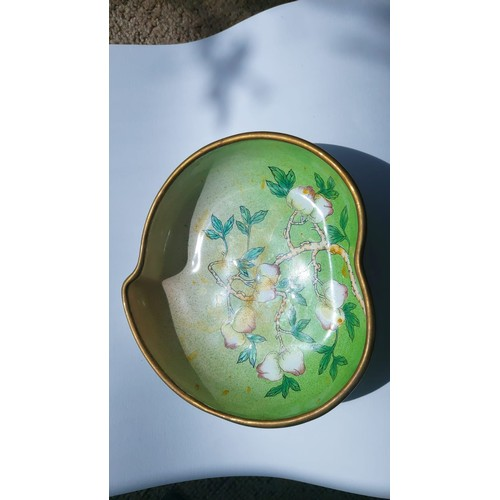83 - A pair of Chinese Canton enamelled dishes, formed as peach stones and decorated with peach branches ...
