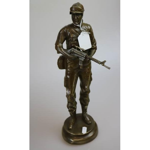21 - A Brass sculpture figure of a soldier...