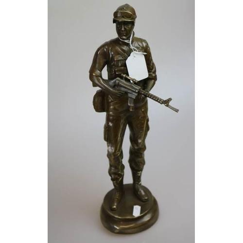 21 - A Brass sculpture figure of a soldier...