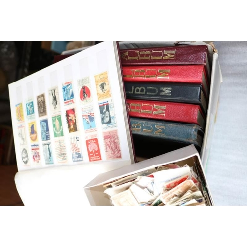 29 - A small carton of world stamps in 6 albums together with loose stamps etc...