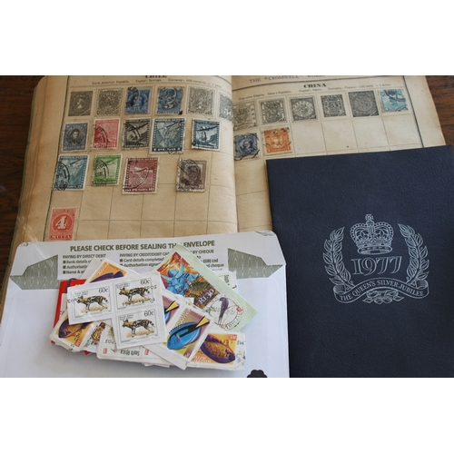 35 - A vintage stamp album together with a small 1977 jubilee album and mint stamps...