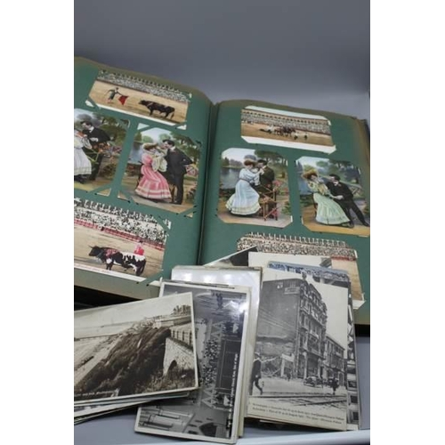 51 - A vintage postcard album together with a quantity of vintage postcards...