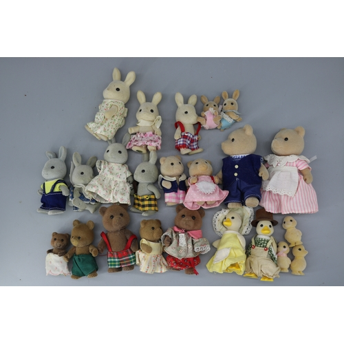 23 - Approximately 60 plus Sylvanian family figures and clothing....