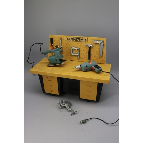 25 - Power Mite tool station with accessories and plug in jigsaw and drill....