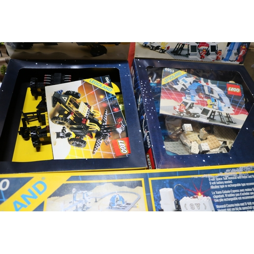 26 - Boxed space Lego 6987, 6941, 6953, 6990 not checked for completeness. Some discolouration to white l...