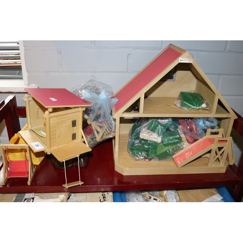 28 - Sylvanian families tree house together with a small house with lots of accessories....
