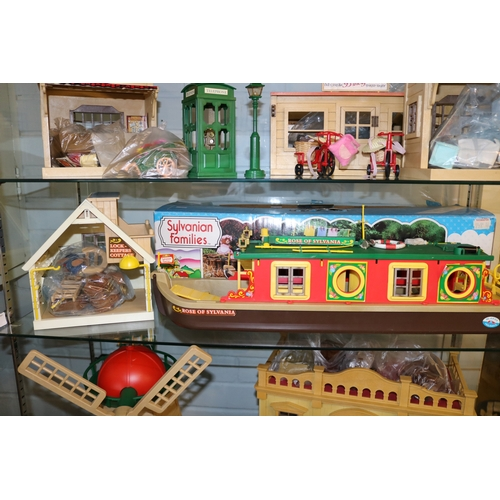 31 - Sylvanian Families lock keepers cottage together with a boxed barge and accessories....