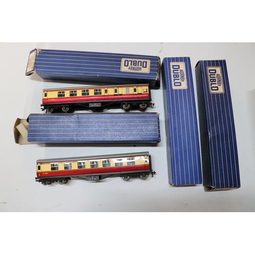 45 - Four boxed Hornby Dublo D12 coaches, Two first and third and two BR Brake....