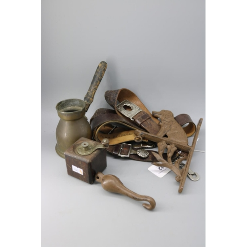 12 - A leather scout belt together with a leather guide belt, a Persian brass coffee pot and grinder, cas...