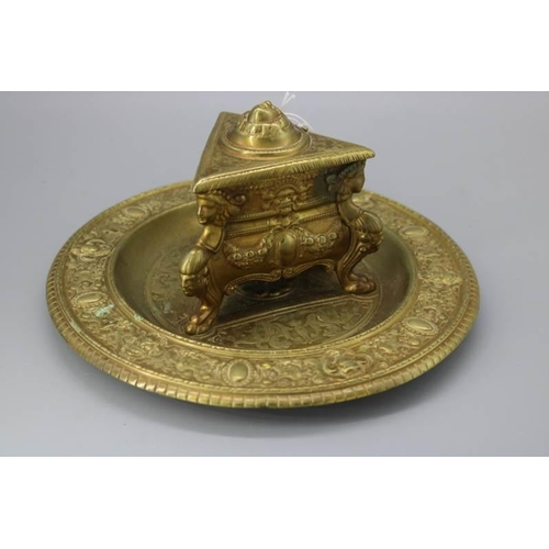42 - Repousse brass inkwell with ceramic liner....