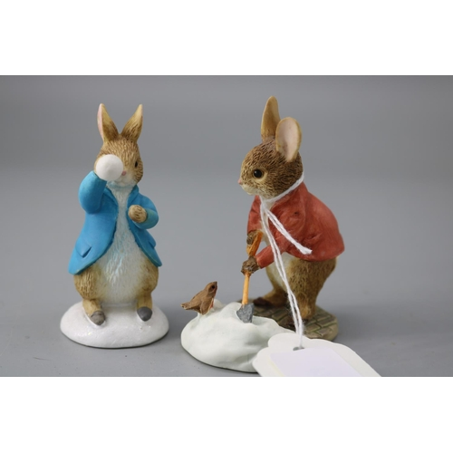 65 - Beatrix Potter two boxed figures Peter Rabbit shovelling snow and Peter Rabbit throwing snowballs...