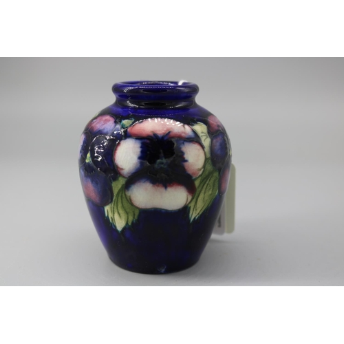 72 - A Moorcroft pansy vase approx 3.5